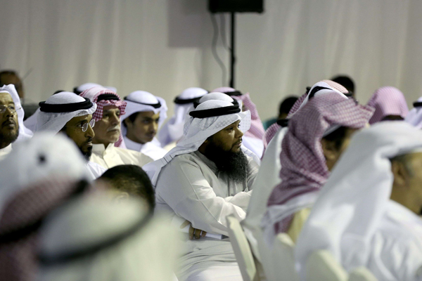 Kuwaitis attend an electoral campaign meeting for Kuwaiti Islamist and former MP candidate Adel al-Damkhi, in Kuwait City in November  2016. (AFP)