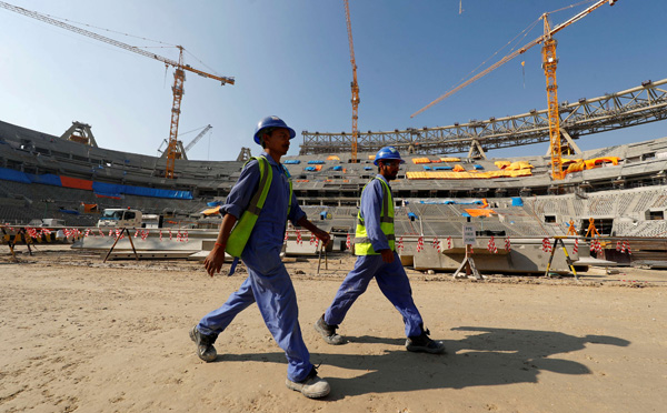 Workers inside the Lusail stadium under construction for the 2022 Fifa football World Cup. (REUTERS)