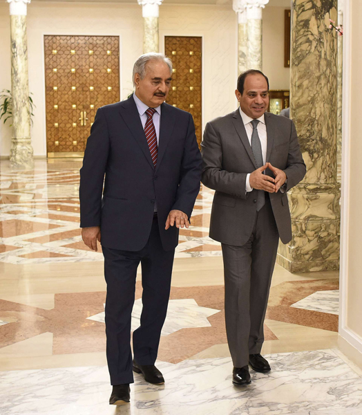 A file picture of Egyptian President Abdel-Fattah el-Sisi, right, meeting with Field Marshal Khalifa Haftar, the head of the Libyan National Army, May 9, 2019 in Cairo, Egypt. (AP)