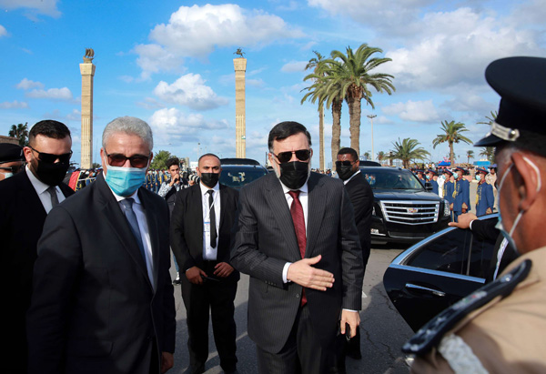 Fayez al-Sarraj (C), Prime Minister of Libya's Government of National Accord (GNA), arrives with GNA Interior Minister Fathi Bashagha (2nd-L) to attend a ceremony in Tripoli, October 8. (AFP)