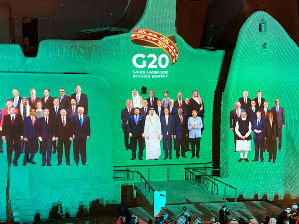 Group photo of annual G20 Summit World Leaders is projected onto Salwa Palace in At-Turaif, Saudi Arabia, November 21. Reuters.