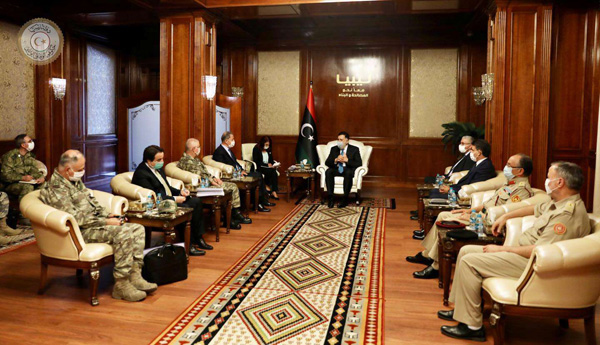 Libyan and Turkish delegations led by GNA's  Prime Minister Fayez al-Sarraj and  Turkish Minister of Defence Hulusi Akar meet in Tripoli. July 3. (Reuters)