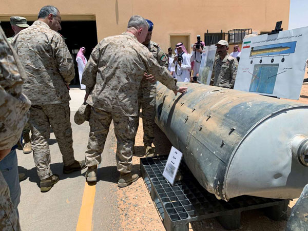 Saudi-led coalition officials show to US Central Command chief General Kenneth McKenzie missiles that is used by Houthi attacks against Saudi Arabia, in Riyadh. (REUTERS)