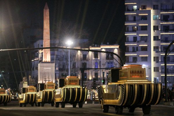 The carriages carrying 22 ancient Egyptian royal mummies advance past the Obelisk of Ramses II along Tahrir Square as they depart from the Egyptian Museum in central Cairo on April 3, 2021. (AFP)