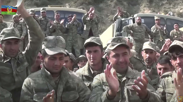 Azerbaijan's solders applaud at a meeting with officers during fighting with forces of the self-proclaimed Republic of Nagorno-Karabakh, Azerbaijan. (AFP)