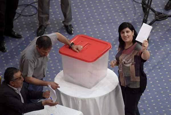 Abir Moussi, leader of the Free Destourian Party (PDL), casts her vote during the plenary session at the parliament in Tunis, July 30. (AFP)