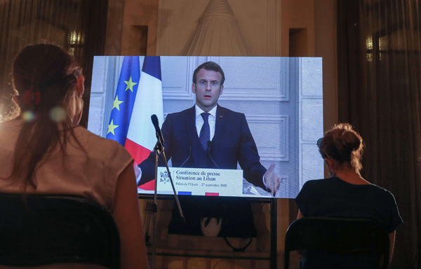 French President Emmanuel Macron addresses Lebanese journalists during a virtual press conference broadcast at the official residence of the French ambassador, in the capital Beirut September 27. (AFP)
