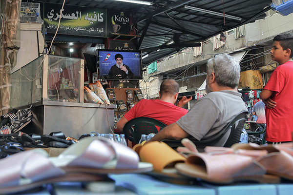 Lebanese listen to a televised speech of General Secretary of Hezbollah Hassan Nasrallah at a cafe in Beirut. (DPA)