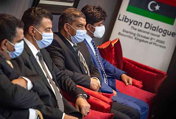 Libyan delegates attend Morocco talks, on October 6. (AFP)