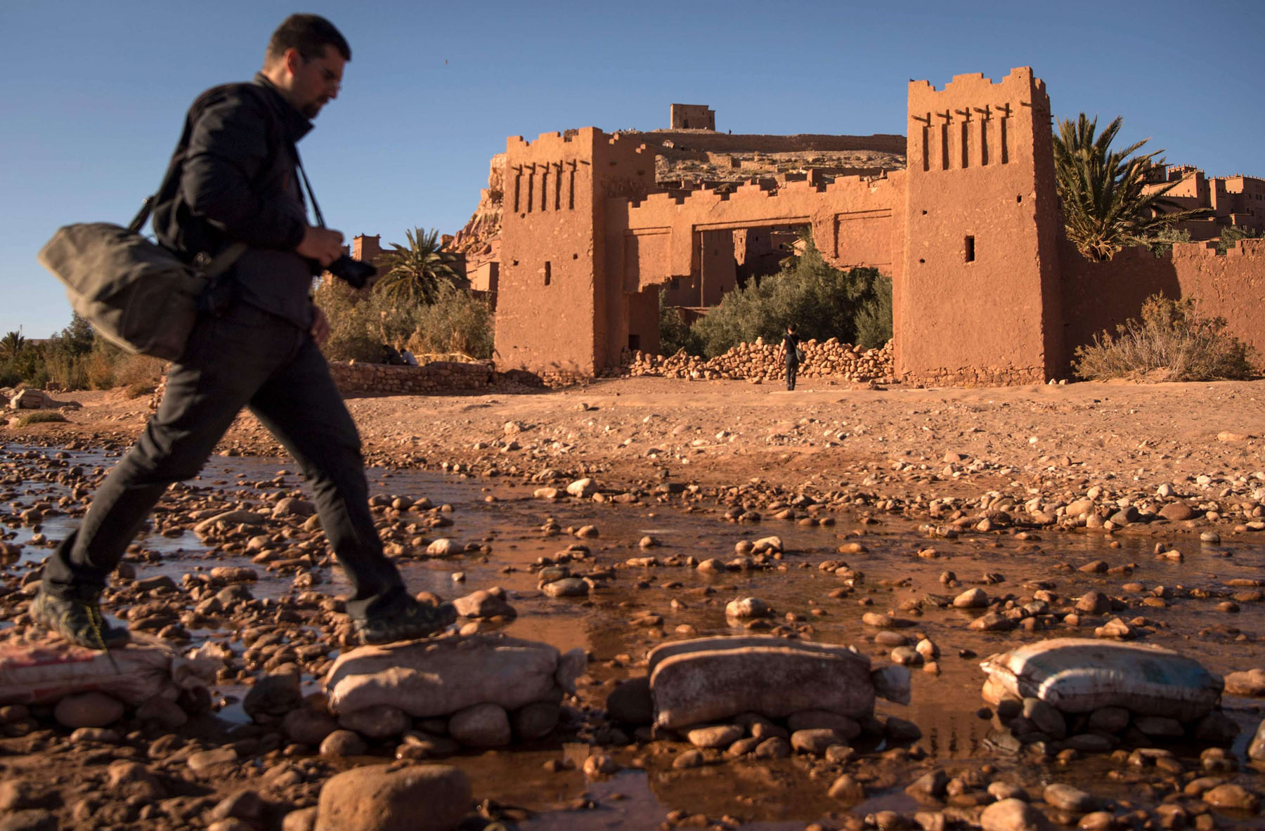 A tourist walks past the ancient fortress of Ait-Ben-Haddou. (AFP)