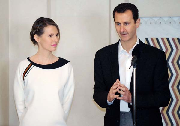 Syrian President Bashar Assad speaking next to his wife Asma in the capital Damascus on March 21, 2016. (AFP)