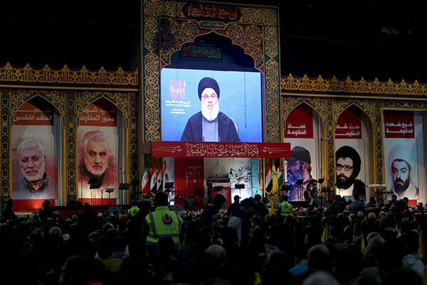 A file picture of Lebanese Hezbollah leader Hassan Nasrallah addressing his supporters through a video screen. (Reuters)