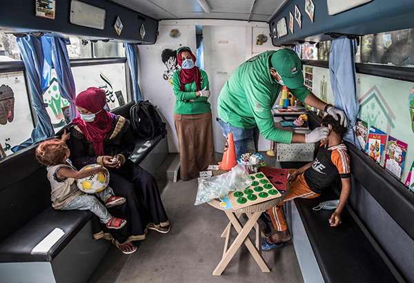 "A homeless child is cared for inside one of the mobile units run by the Egyptian authorities and used as part of the ""Atfal bala ma'wa"" (Children without a home) social program, in the capital Cairo's Abbasia district. (AFP)"