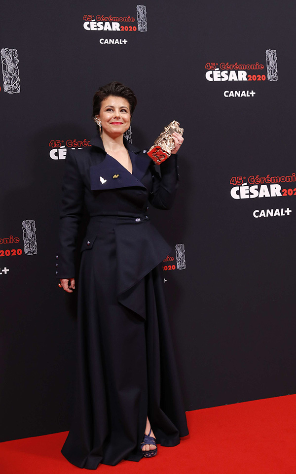 "Mounia Meddour holds her Cesar award for Best First Film for the movie ""Papicha"" on February 28, in Paris. (AP)"