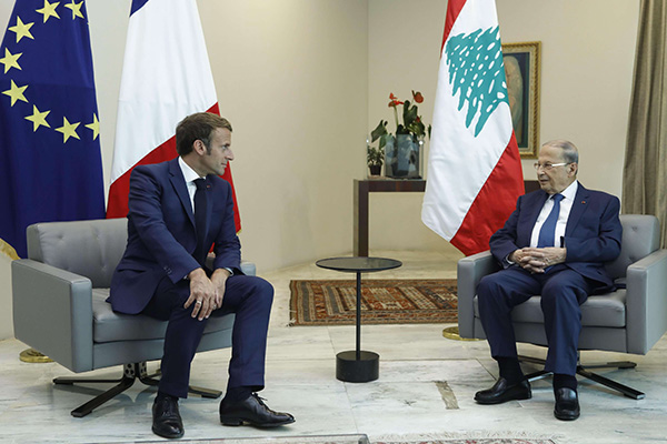 Lebanese President Michel Aoun (R) meets with French President Emmanuel Macron at Baabda Palace in Beirut, August 6. (Reuters)