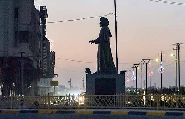 The statue of the Arab poet Abu Tammam, erected in the centre of a square in the western half of Iraq's northern city of Mosul. (AFP)