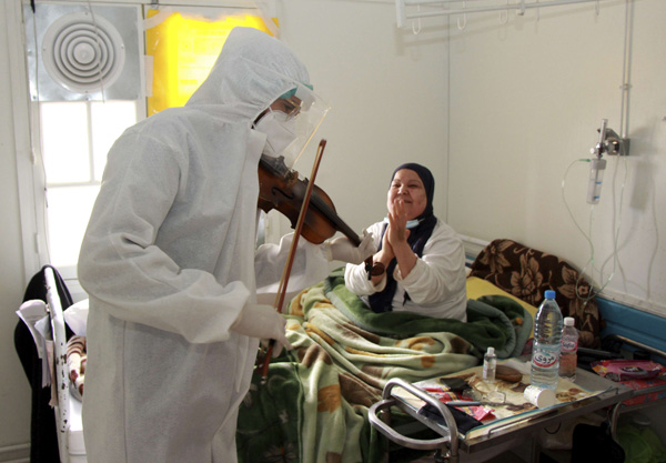 Dr Mohamed Salah Siala plays the violin for patients on the COVID wards of the Hedi Chaker hospital in Sfax, southern Tunisia. AP