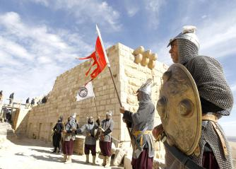 Jordanian men dressed as ancient  Islamic soldiers perform during a show for visitors at the Shobak Castle. (Reuters)