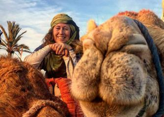 Adventurer Alice Morrison posing with a camel. (Instagram)