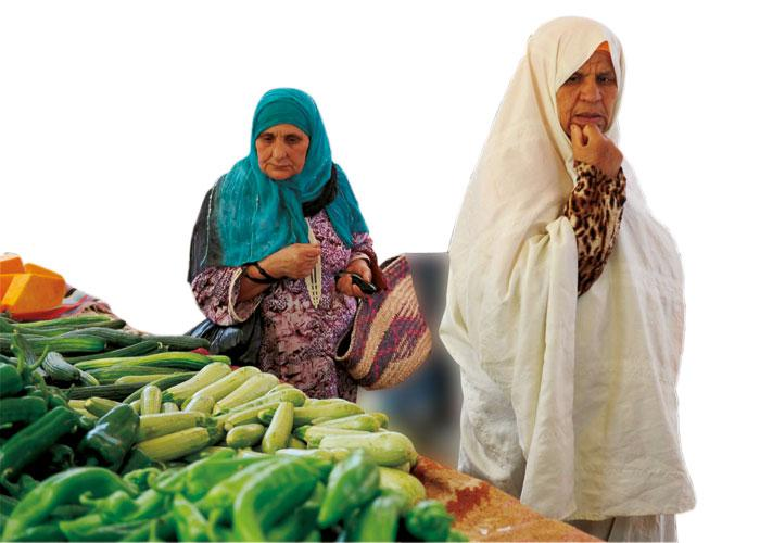 Tunisian women at a vegetable market in Ettadhaman city, near Tunis. (AFP)