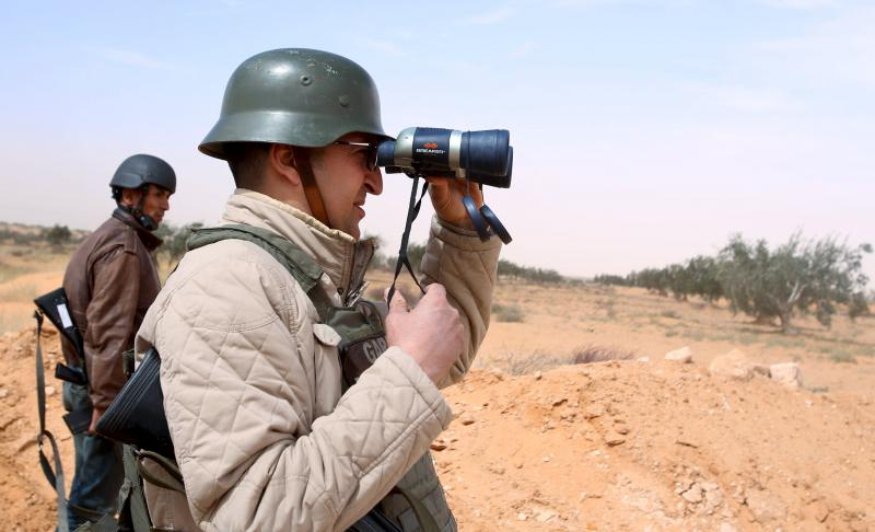 A Tunisian policeman looks through binoculars during a military operation near the town of Ben Guerdane. (Reuters)