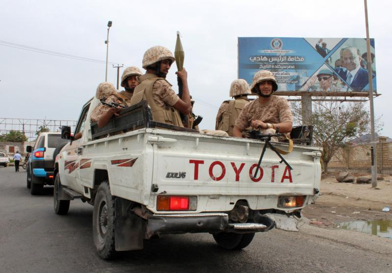 Fighters from Yemen's Southern Transitional Council sit in the back of a pickup truck in Aden, on January 28.  (AFP)