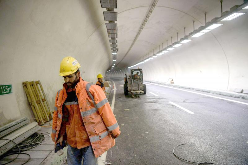 Construction workers walk inside a new tunnel in Istanbul. (AFP)