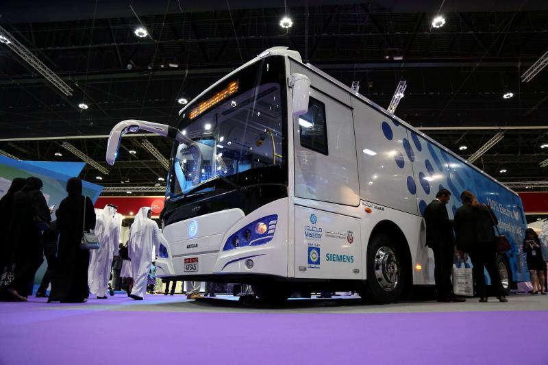 Visitors take a look at the ECO Bus manufactured by Masdar during the Abu Dhabi Sustainability Week in Abu Dhabi, on January 17.       	 											                                        (Reuters)