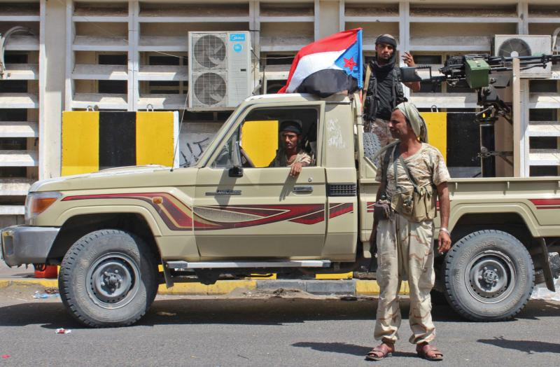 Fighters from the separatist Southern Transitional Council patrol the Old City of the government's de facto capital Aden, on January 30. (AFP)