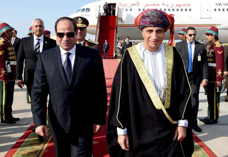 Red-carpet treatment. Omani Deputy Prime Minister Fahd Bin Mahmud al-Said (R) welcomes Egyptian President Abdel Fattah  al-Sisi upon his arrival in Muscat, on February 4.     (AFP)