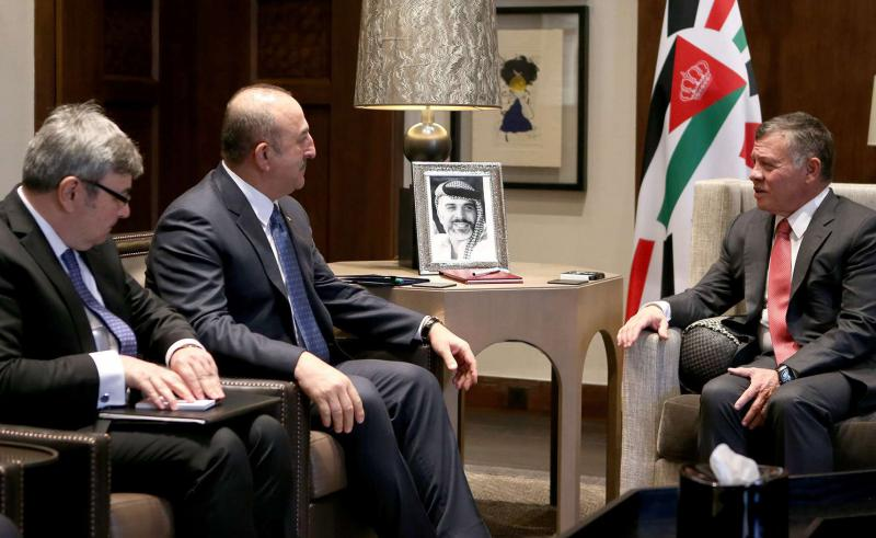 King Abdullah II (R) meets with the Turkish Foreign Minister Mevlut Cavusoglu in Amman, on February 19. (Jordanian Royal Court)