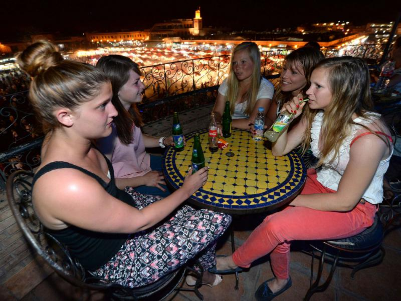 Tourists enjoy beverages on a terrace overlooking the Jemaa el-Fna square in Marrakech. (AFP)