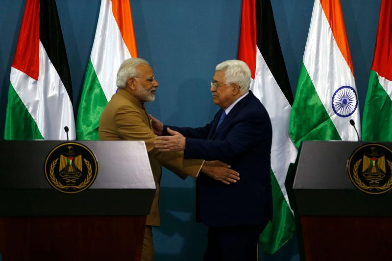 Palestinian Authority President Mahmud Abbas (R) and Indian Prime Minister Narendra Modi embrace in the West Bank city of Ramallah on February 10. (AFP)