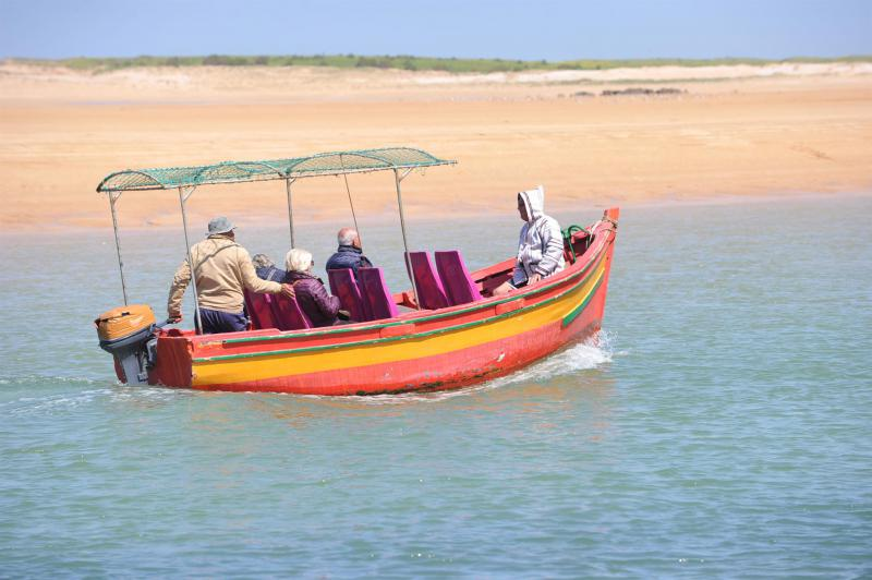 Tourists on a boat in Morocco's coastal village of Oualidia. (Saad Guerraoui)