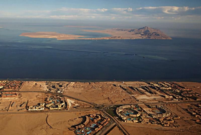 An aerial view of the Red Sea's Tiran (foreground) and Sanafir (background) islands in the Strait of Tiran between Egypt's Sinai Peninsula and Saudi Arabia.  (AFP)