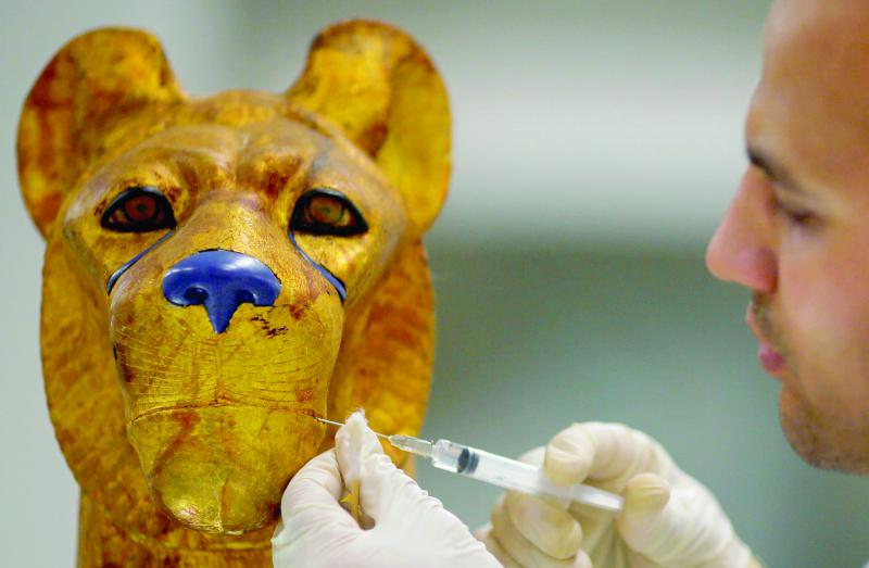 An archaeological technician uses a chemical injection              to renovate a pharaonic shaped animal that belonged to the              Golden King Tutankhamun in the conservation centre of the              Grand Egyptian Museum. (Reuters)