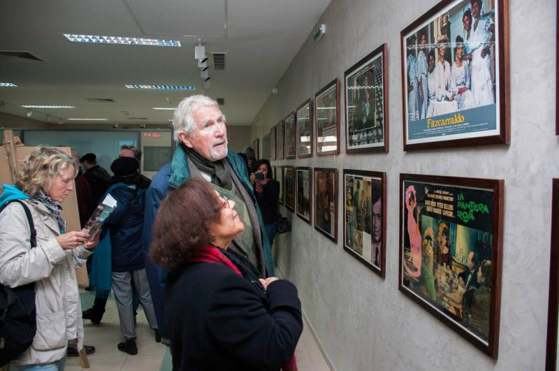 Visitors look at movie posters at the City of Culture complex in Tunis. 		(City of Culture)