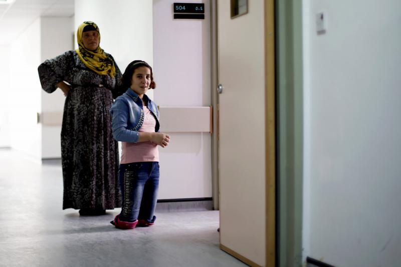 A Syrian girl who was injured during the violence in her country four years ago stands in front of her room in a hospital in Amman. 				                         (Reuters)