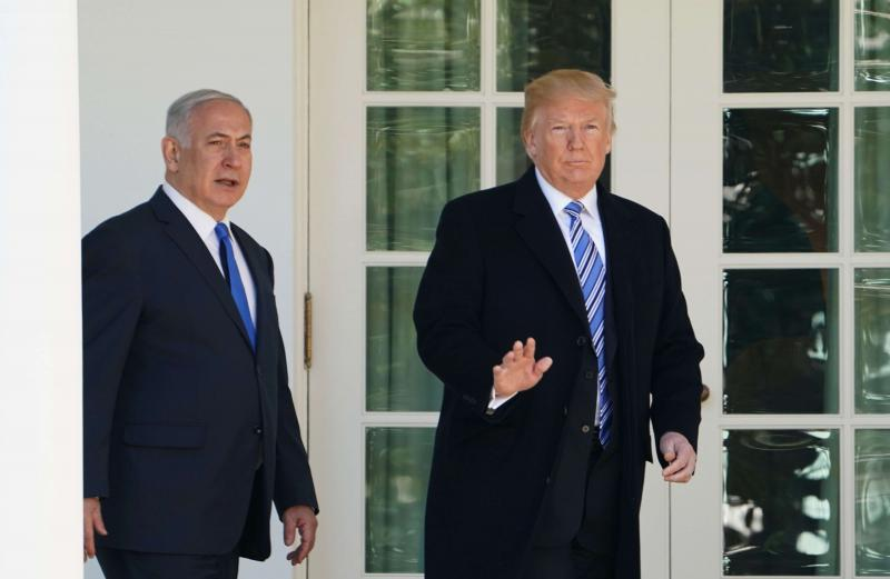 US President Donald Trump (R) walks with Israeli Prime Minister Binyamin Netanyahu at the White House in Washington, on March 5.     (AP)