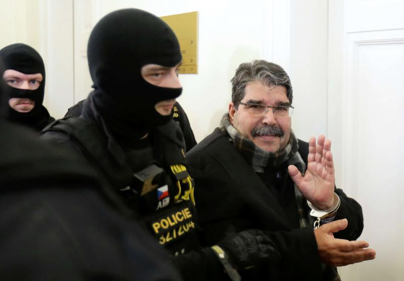 Former leader of Kurdish Democratic Union Party (PYD) Saleh Muslim is escorted to a Czech court in Prague, on February 27. (Reuters)