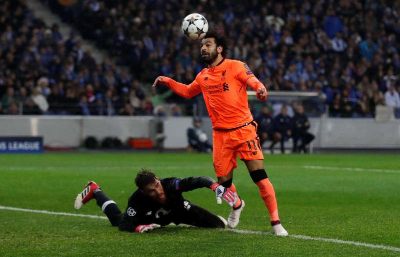 d9039ef6055 Liverpool s Mohamed Salah (R) goes past FC Porto s Jose Sa before scoring  the team s