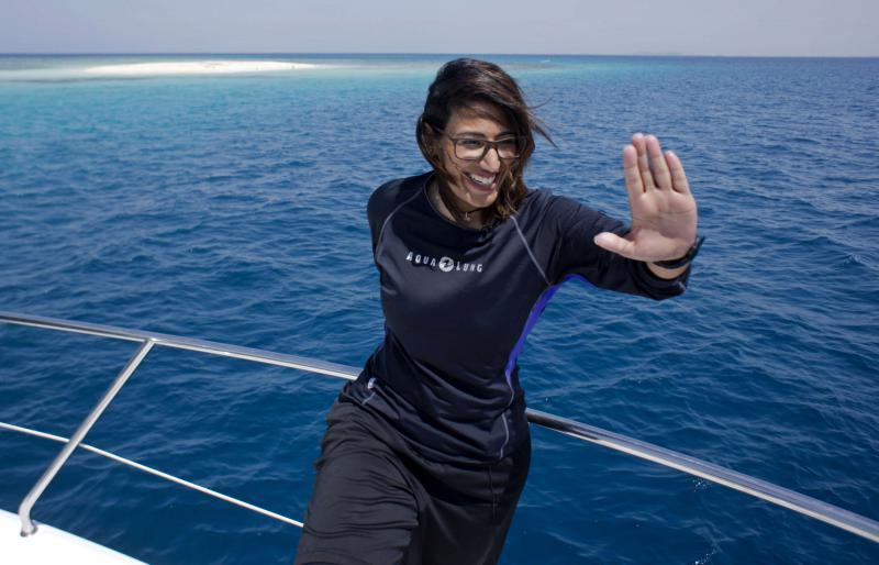 Nouf Alosaimi, a 29-year-old female Saudi dive instructor, prepares to explore the waters off a Saudi island in the Red Sea. (AP)