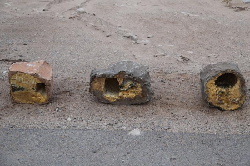 Three explosives disguised as rocks on display in Yemen. (Conflict Armament Research)
