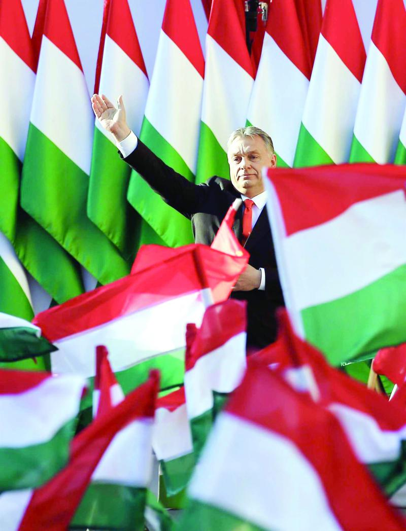 Barbed wire politics.  Hungarian Prime  Minister Viktor Orban waves during the final electoral rally of his Fidesz party in Szekesfehervar,  on April 6.     (AP)