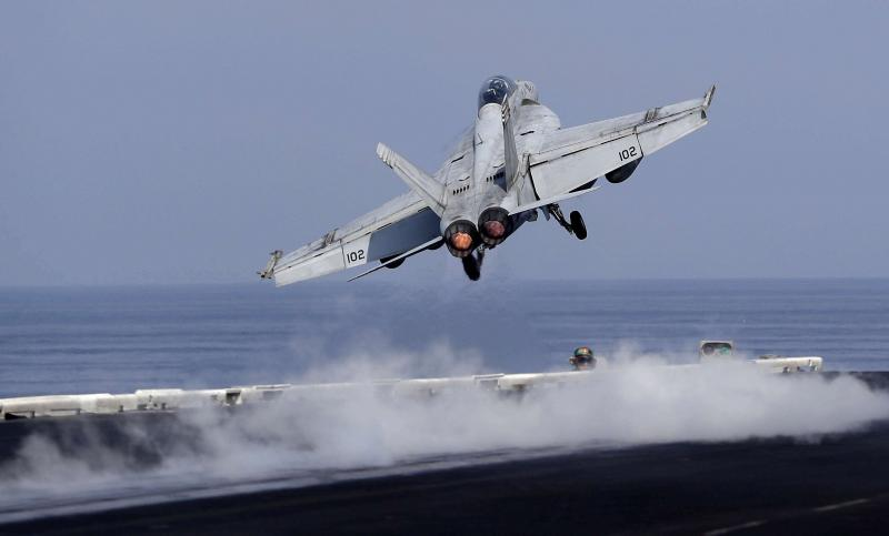 US Navy fighter jet takes off from the deck of the USS. Dwight D Eisenhower aircraft carrier. (AP)
