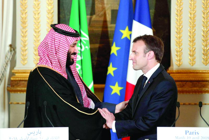 French President Emmanuel Macron (R) and Saudi Crown Prince Mohammed bin Salman bin Abdulaziz shake hands following a press conference in Paris, on April 10. (Reuters)