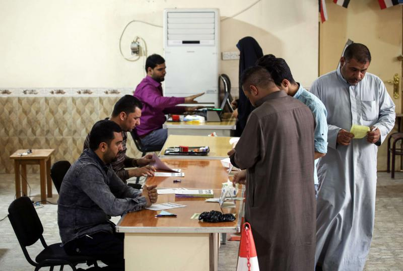 Iraqis visit an electoral commission office to renew their voting registry records in Najaf, on March 10