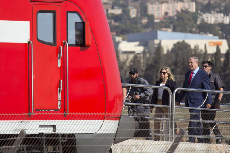 Another brick in the wall. A 2016 file picture shows Israeli Prime Minister Binyamin Netanyahu and his wife Sara during an inauguration ceremony of Hahemek rail line.  (AP)