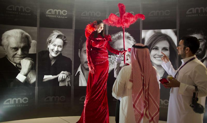Saudi arabia ushers in new era of movie entertainment samar kadi aw visitors attend an invitation only screening at the king abdullah financial district stopboris Gallery