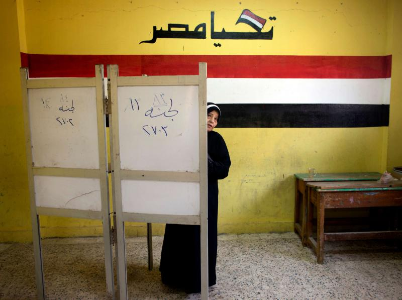 A woman votes in the presidential election in Cairo, last March. (AP)